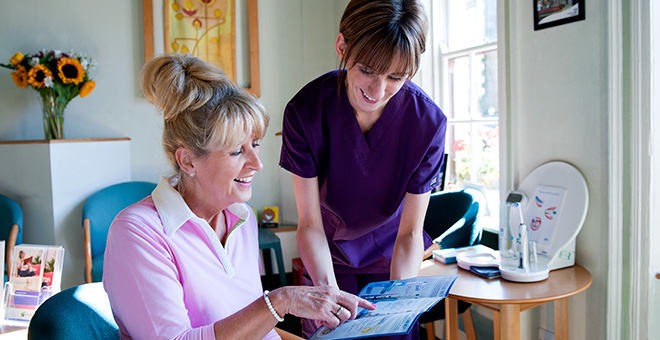 sharing patient resources in the waiting room at Church Court Dental Practice Dumfries